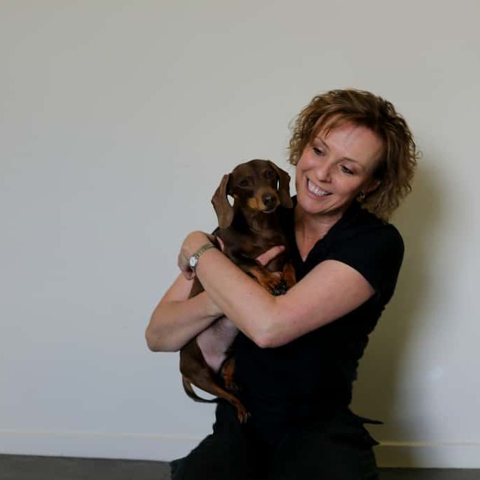 Michelle Monk Inside Her Rehabilitation Clinic With Cute Dachshund